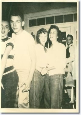 This was during one of the Humes High dance functions in August 1952, Elvis had been one of the students to volunteer as an usher, helped setup tables, food, drinks, hence why he is dressed smartly. The other students there are actually 1 year ahead of him.