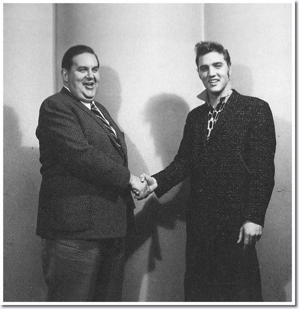Elvis Presley and Steve Sholes.