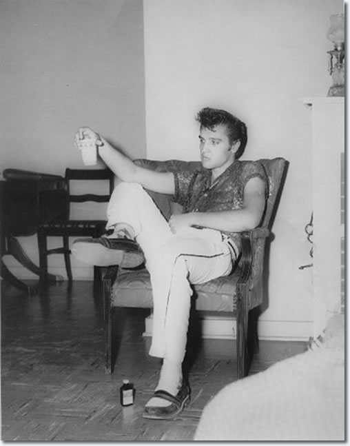 Elvis Presley in the Manager's house at the Drive-In - July 15, 1955.