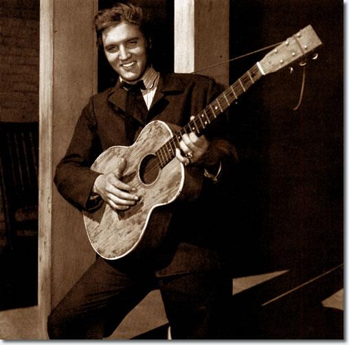 Elvis Presley on the set of 'Love Me Tender'. From the book, Inside Love Me Tender