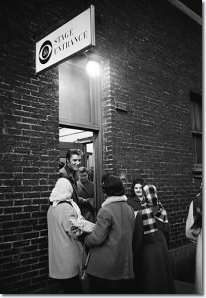 "Elvis chats with some very cold well wishers who came to greet him during near freezing weather the day he appeared for the first time on the Tommy and Jimmy Dorsey variety show, ""Stage Show,"" produced by Jackie Gleason. (CBS Studio 50, New York City, March 17, 1956)."