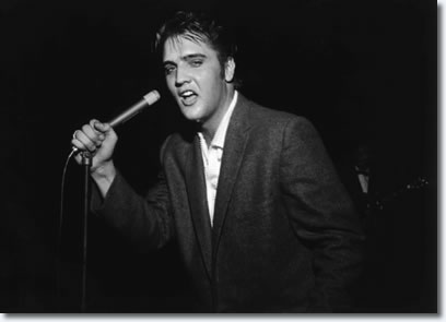 More than 7,000 people jammed Ellis Auditorium on the night of May 15, 1956, to stomp, shudder, shriek and sigh as a young Elvis Presley writhed his way through a rock and roll repertoire. Presley was the blockbuster of Bob Neal's Cotton Picking Jamboree, a feature of Cotton Carnival opening night.