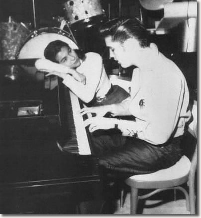 Elvis plays the piano for fan Judy Spreckles