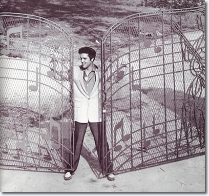 Elvis Presley at the new music gates Graceland in 1957