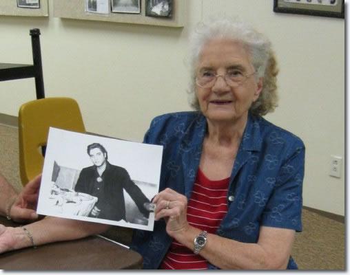 Aline Landrum with a photo of Elvis Presley taken September 12, 1957.