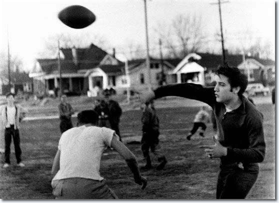 Elvis Presley fades back and heaves a pass during a sandlot touch football game. It connected for one of the many touchdowns.