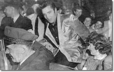 George Corrie (chauffeur) drives Elvis and fan club contest winner around Empire Stadium prior to start of the show