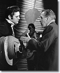 Elvis Presley talks with Ed Sullivan