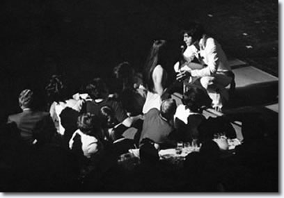 Elvis shares a moment with Priscilla while on stage at the International Hotel in Las Vegas.