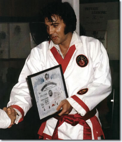 Elvis receives his 7th degree black belt from Kang Rhee.