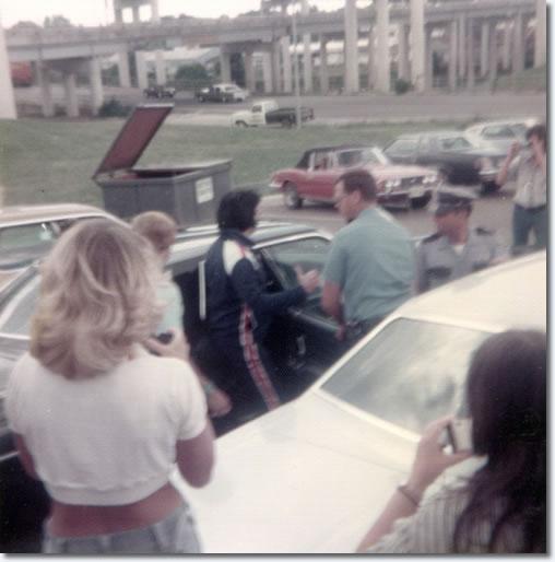 Elvis Presley Leaving His Hotel On His Way To Baton