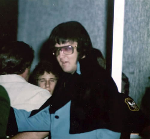 Elvis Presley just after arriving on the Lisa Marie, heading to his