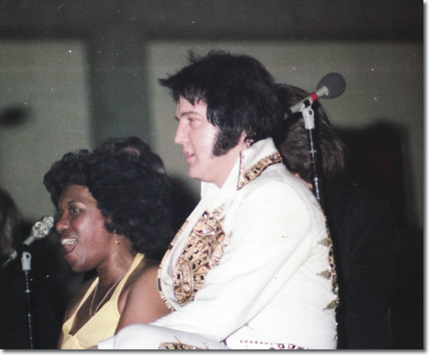 Elvis Presley takes a break during his performance, Macon, GA on June 1, 1977.