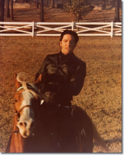 Elvis Presley at Graceland riding Rising Sun
