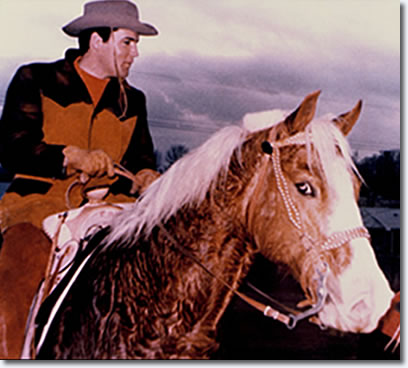 Elvis Presley at his Circle G Ranch, Mississippi riding Rising Sun.