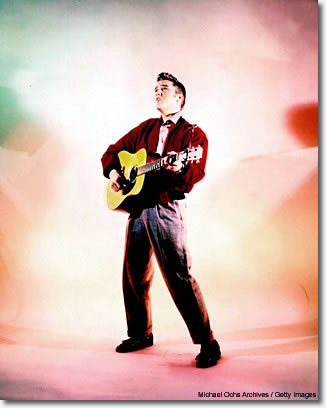 1956: I believe this was the first color handout from RCA [Elvis' label]. They gave it to newspapers as 35mm slides. The way they deified him, from the colors to the lighting to the pose, it's totally godlike. If you want an image that sums up the true beauty of rock 'n' roll, this is so beatific it's almost beyond description.
