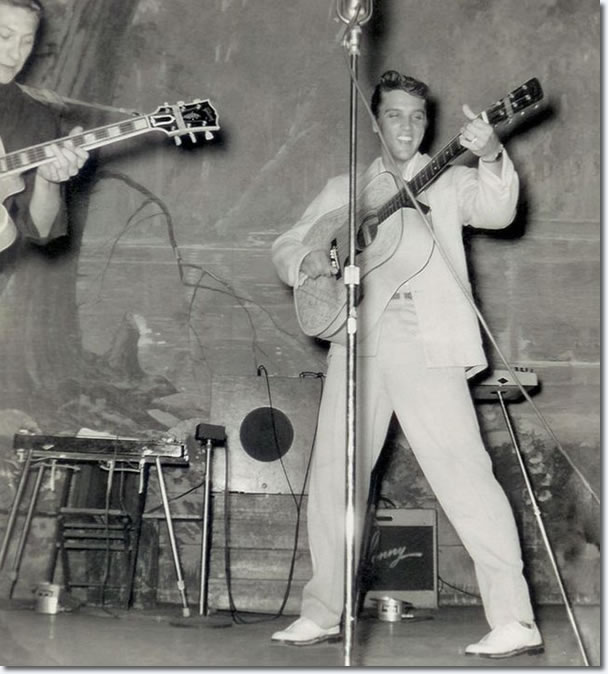 The Hillbilly Cat, as Elvis was nicknamed, performing on stage at the Louisiana Hayride in Shreveport on August 13, 1955. That night, Elvis sang his first record 'That's All Right' and his current first national country hit 'Baby, Let's Play House'. He also rocked the audience with and a cover of Chuck Berry's 'Maybellene'.