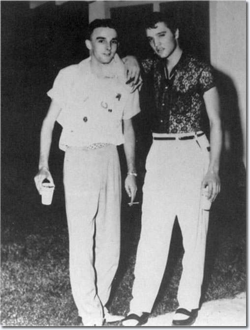 A local fan and ElvisPresley behind the Drive-In Manager's house - July 15, 1955.