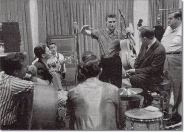 Bill Black, Chet Atkins, Scotty Moore, D.J. Fontana, Elvis Presley, Ben Spear and Steve Sholes - April 14, 1956