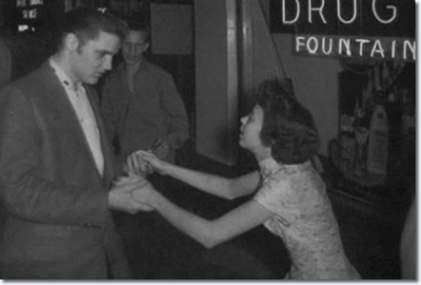 Elvis Presley with a fan after the show : April 15, 1956.