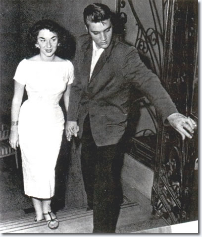 Elvis and contest winner, Andrea June Stephens, walk into the hotel lobby : August 10, 1956, Jacksonville.