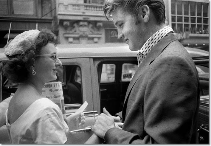 Having arrived at the Hudson Theater in New York City to perform on the Steve Allen comedy show, Elvis is greeted by a female fan who had come all the way in from Long Island to meet her idol. (New York City, July 1, 1956)