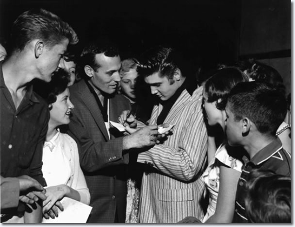 Carl Perkins and Elvis Presley swap autographs, Overton Park Shell, Memphis June 1, 1956