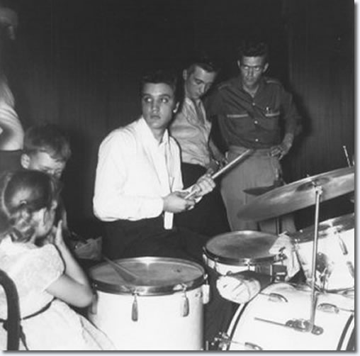 Elvis back at the drums in between shows at the Mosque - June 30, 1956