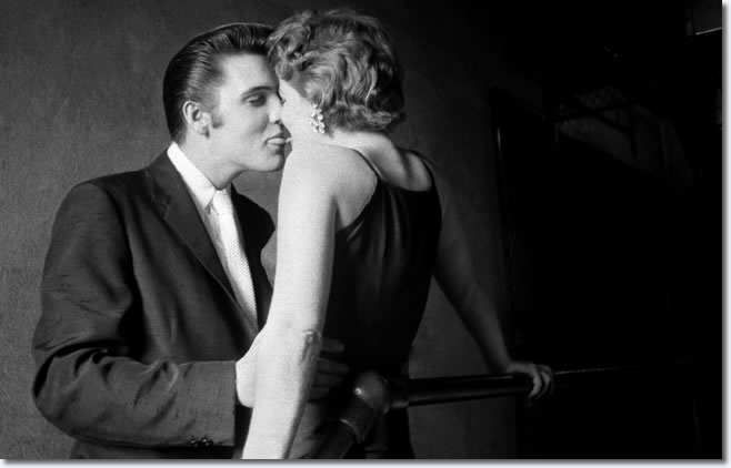 Sneaking a kiss moments before going onstage - June 30, 1956
