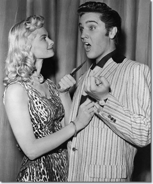 Irish McCalla the exotic looking star the of TV series 'Sheenah Queen Of The Jungle' jokes with Elvis Presley backstage.