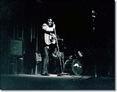 A spotlight captured Elvis on stage at the Minneapolis Auditorium.