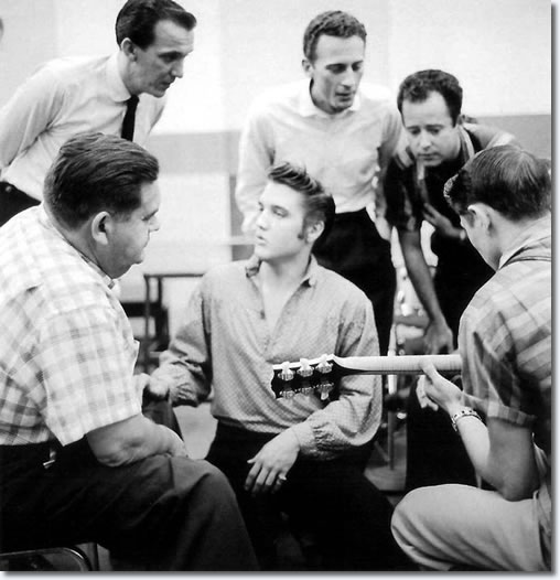 L-R Steve Sholes sat foreground, Hugh Jarrett stood behind him, Elvis centre, with Hoyt Hawkins and Gordon Stoker look over to Scotty Moore on the right of frame with his 1954 L5 CESN.