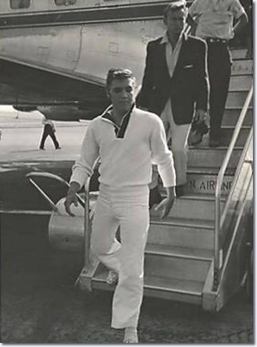 Elvis Presley and Nick Adams disembarking at Memphis Airport.