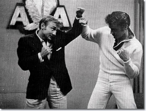 Elvis & Nick Adams are pretending to fight is because Elvis just met with Heavyweight champ Rocky Marciano