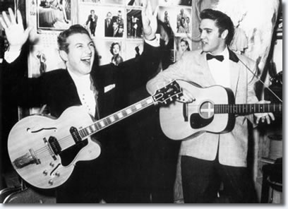 Liberace hams it up with Elvis backstage at The New Frontier