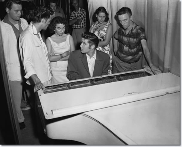 Elvis Presley back stage at the piano : Jacksonville, August, 1956.