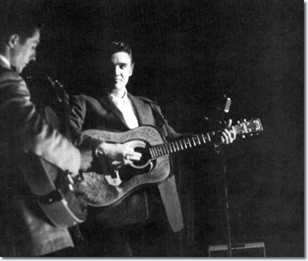 Scotty Moore and Elvis on stage.
