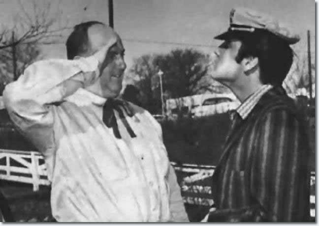 Elvis delivers his Christmas present, a red BMW Isetta, to Colonel Parke