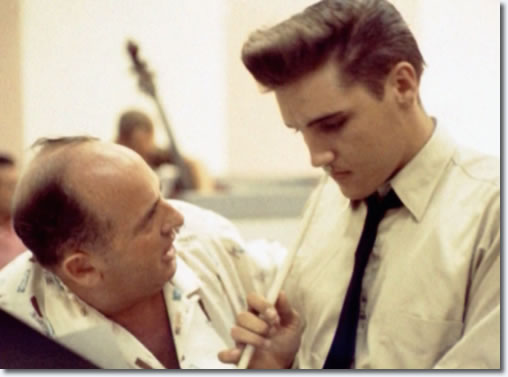 Colonel Tom Parker talks with Elvis Presley at the June 10 1958 Recording Session.