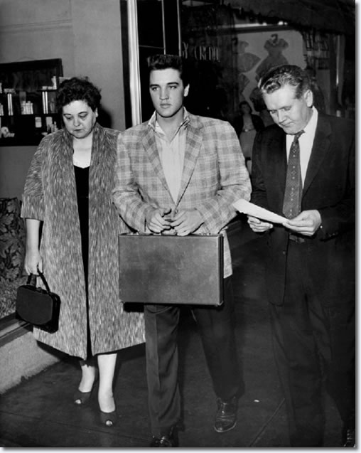 Flanked by his parents, Gladys & Vernon, Elvis Presley reported for Army duty to the Draft Board office in the M &M Building at 198 South Main about 6:30 a.m. March 24, 1958. After undergoing processing and a physical at Kennedy Veterans Hospital, he and other inductees would board a bus for Fort Chaffee, Arkansas later that afternoon. By the 28th, Elvis arrived at Fort Hood, Texas where he would undergo six months training before shipping off to Germany. His mother would die before he completed training.