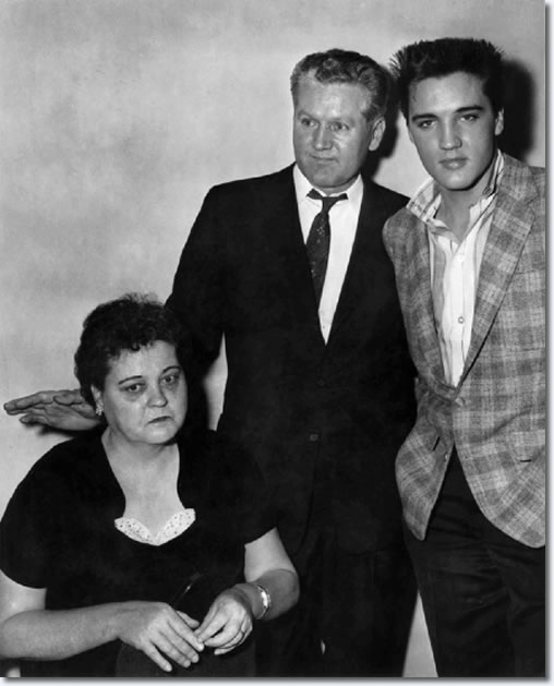 Elvis Presley at the draft board with his parents, Gladys and Vernon Presley in 1958. Elvis reported for Army duty to the Draft Board office in the M &M Building at 198 South Main about 6:30 a.m. March 24, 1958. After undergoing processing and a physical at Kennedy Veterans Hospital, he and other inductees would board a bus for Fort Chaffee, Arkansas later that afternoon. By the 28th, Elvis arrived at Fort Hood, Texas where he would undergo six months training before shipping off to Germany. His mother would die before he completed training.
