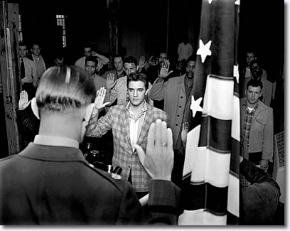 Elvis Presley is sworn in on the day of his induction into the army March 24, 1958. Maj. Elbert P. Turner adminstered the oath.