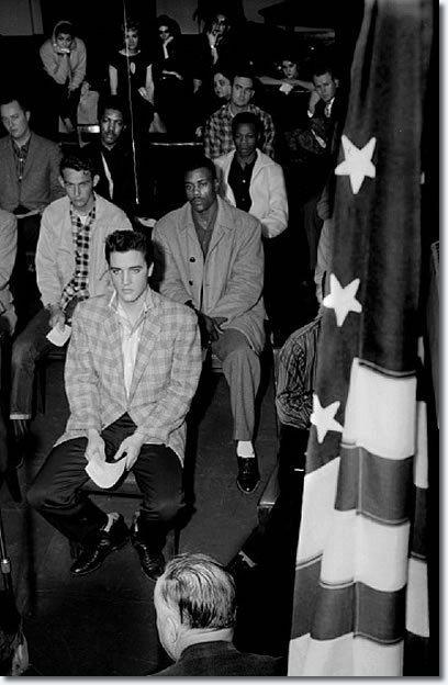 Elvis Presley on the day of his induction into the army March 24, 1958. After reporting for duty about 6:30 a.m. at the Draft Board office in the M&M Building, 198 South Main, he and other inductees would spend much of the day at Kennedy Veterans Hospital for processing and physicals before boarding a bus for Fort Chaffee, Arkansas. By the 28th, Elvis arrived at Fort Hood, Texas where he would undergo six months of training before shipping off to Germany.