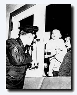 Elvis chats to young fans through one of the terminal doors