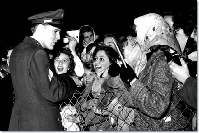Elvis meets local fans at the perimiter fence and signs autographs