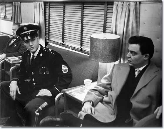 Elvis Presley during the last few miles of the train ride home Monday March 7, 1960
