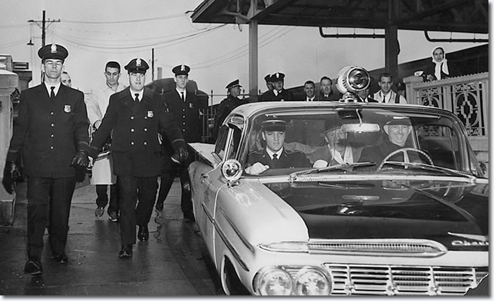 Elvis rides out to Graceland, in his friend Police Captain Fred Woodward's(Driving) squad car, Bill Burk can be seen in the back seat.