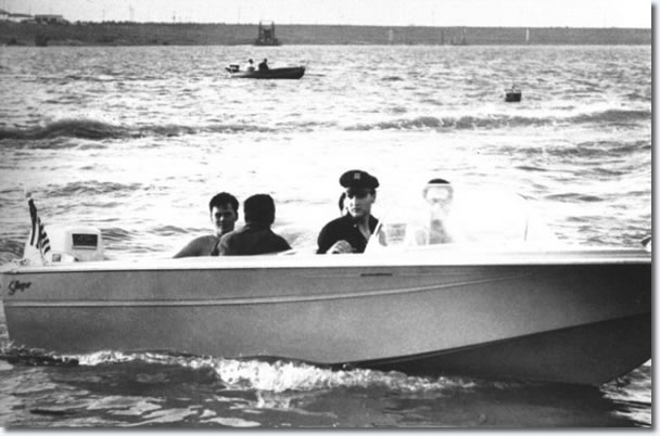 July 8, Elvis takes a spin around McKellar Lake in his new $2000 16-foot boat to water ski boat.