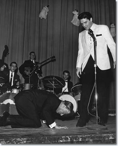 Comedian George Jessel hit the stage in an exaggerated salaam to the King of rock and roll at Elvis' evening performance at Ellis Auditorium Feb. 25, 1961