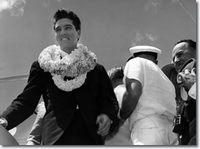 Elvis Presley : March 25, 1961 : Arriving at Honolulu Airport for that evenings U.S.S. Arizona Benefit Concert.